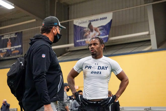 Former Kent State star wide receiver Isaiah McKoy speaks to a scout from the NFL's Carolina Panthers during Pro Day, held last March at the KSU Field House.