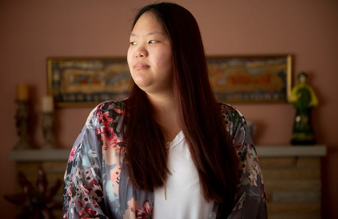Remi Mikan, 21, a recent Kent State graduate, talks about discrimination at her home in Canfield.