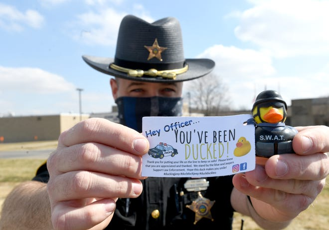 Stark County sheriff's deputy Bradley Green shows off a rubber duck he received as a sign of appreciation when he stopped a motorist last week.