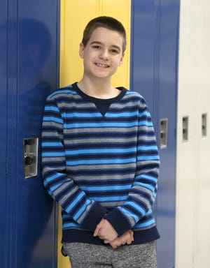 Kean Archer of East Canton Middle School is a Canton Repository United Way of Greater Stark County Kid of Character for March. He is shown at the school on Tuesday, March 16, 2021.