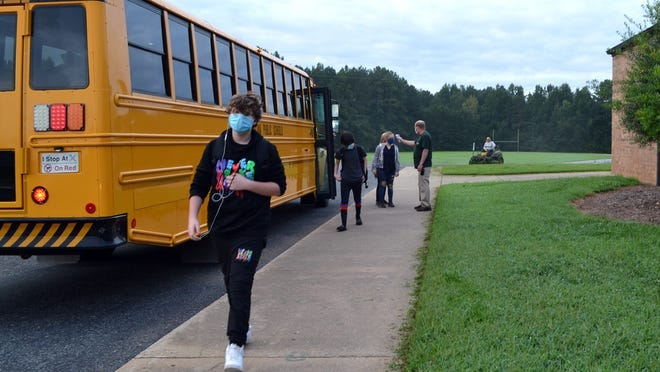 Students at Crest Middle School arrive for class on the first day of school.