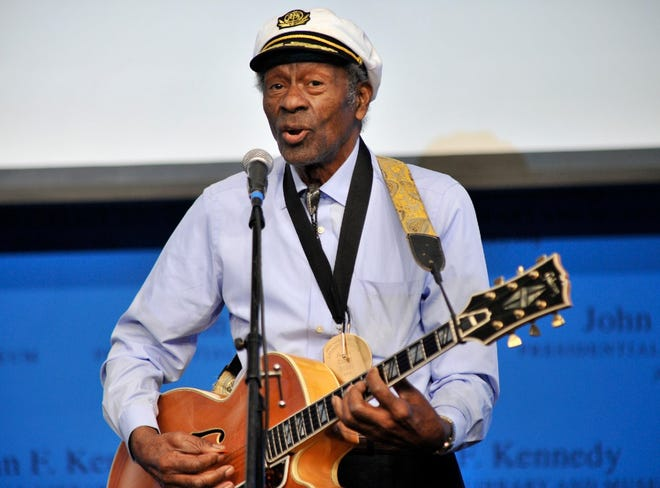 """Chuck Berry, rock 'n' roll's founding guitar hero and storyteller who defined the music's joy and rebellion in such classics as """"Johnny B. Goode,"""" ″Sweet Little Sixteen"""" and """"Roll Over Beethoven,"""" died March 18, 2017, at his home west of St. Louis at age 90. In this Feb. 26, 2012 photo, Berry plays """"Johnny B. Goode"""" at the John F. Kennedy Presidential Library and Museum in Boston, an event where he and Leonard Cohen were honored with Awards for Song Lyrics of Literary Excellence."""