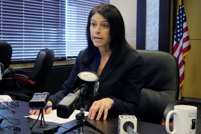 FILE - In this March 5, 2020 file photo, Michigan Attorney General Dana Nessel addresses the media during a news conference in Lansing, Mich. Nessel on Monday, March 15, 2021 declined Republicans' request to investigate whether nursing home orders issued by Gov. Gretchen Whitmer led to COVID-19 deaths or if related data is inaccurate, citing a lack of evidence that any law was violated. (AP Photo/David Eggert, File)
