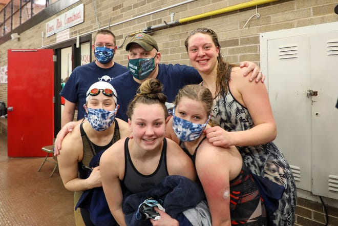 The Sault High girls 400 freestyle and 200 medley relay team won in record time at UP Finals this past Saturday. The relay team includes, front row, from left: Anna Hildebrand, Aliah Robertson, Julie Innerebner and Joanne Arbic. Pictured in back, from left: Sault assistant coach Clare Arbic and Sault head coach Steve Habusta.
