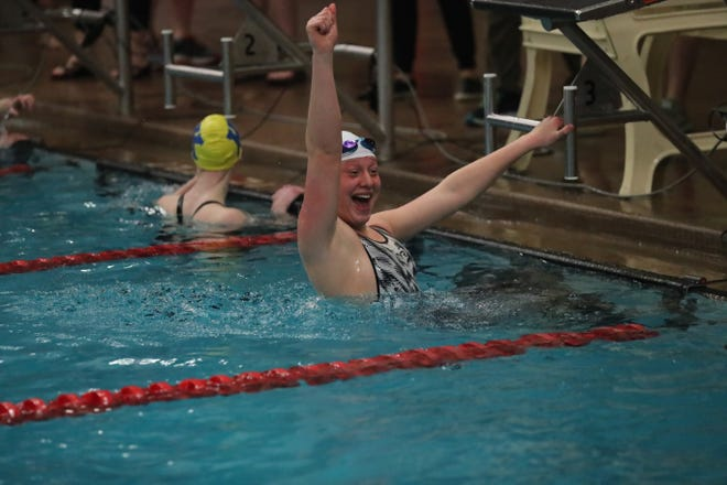 Sault High's Joanne Arbic celebrates her win in the 50 freestyle at UP Swimming and Diving Finals Saturday at Marquette. Arbic won the 50 and 100 freestyle events for a third straight year.