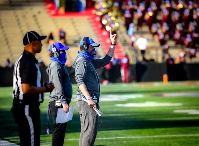 Savannah State Assistant Head Coach/Co-Offensive Coordinator Russell DeMasi signals to players during the Gulf Coast Challenge game against West Alabama on Saturday, March 12, 2021 at Ladd-Peebles Stadium in Mobile, Ala.