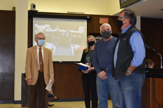 Shawnee Mayor Ed Bolt, second from right, stands with Avedis Foundation board members, Dr. John Robinson, at left, Sarah Haselwood, center, and Chuck Skillings, at right.  Avedis made a proclamation this week to honor first responders.
