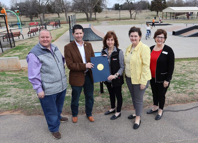 State Rep. Dell Kerbs and State Sen. Zack Taylor present a proclamation to the Tecumseh Public Library's Cyndi Seeley and Beth Lyle, and Regional Coordinator Peggy Cook at Slick Humphrey Park. The library has debuted a Story Walk along the walking trail in the park, where visitors can experience a book while on their walk.