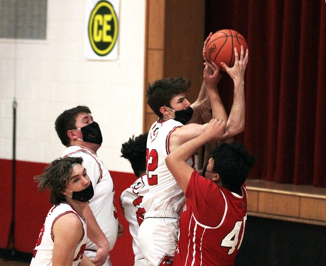 Nate Wagner of Colon hauls in a rebound in Monday's win over Battle Creek St. Philip.