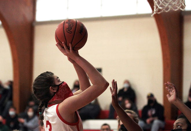 Lexus Gentz scores two of her game-high 17 points for Colon on Monday.