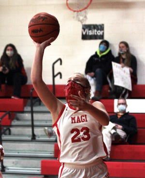 Reese Williams of Colon rises up to score two points for the Lady Magi on Monday.