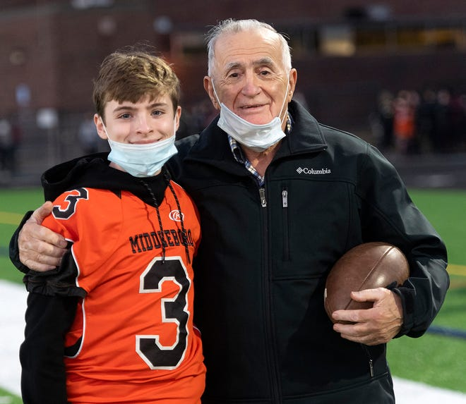 Serving as honorary team captain and official coin tosser for last Friday night's football season opener at Middleboro High School, 91-year-old Rocky Savas is joined by his great-grandson Nate Goodine during pre-game ceremonies at the new multi-use field at MHS. Savas played his first football game at what was the new Battis Field 79 years ago. The Sachems hosted Bridgewater-Raynham in the first football game played at the new field, with BR taking the win, 26-6.