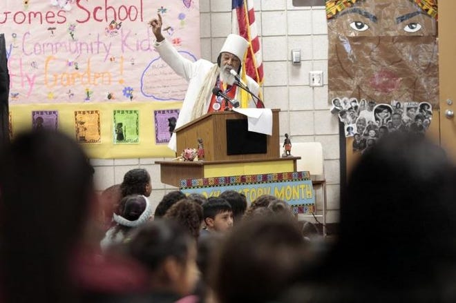 Jibreel Khazan visits students at Gomes School in New Bedford in in this file photo from 2018.