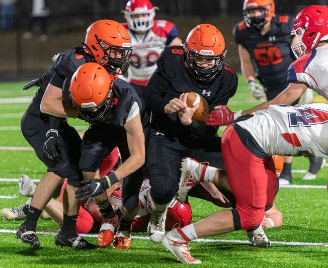 Nick McGourthy and Connor Fahey block for quarterback Tim Crowley.