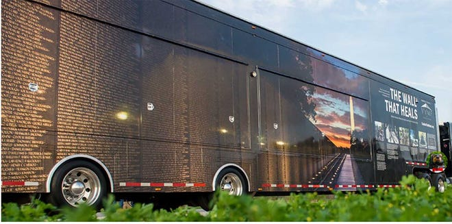 The 53-foot trailer that carries The Wall That Heals transforms to become a mobile Education Center.