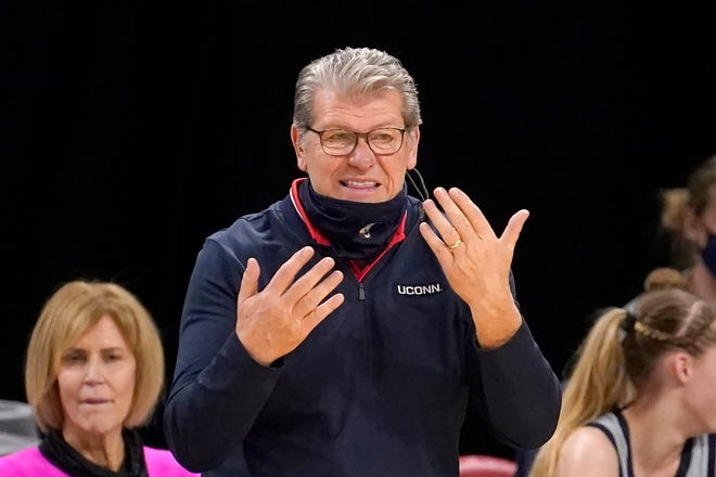 Connecticut head coach Geno Auriemma motions to his players during the second half of an NCAA college basketball game against the DePaul Sunday, Jan. 31, 2021, in Chicago. Connecticut won 100-67.