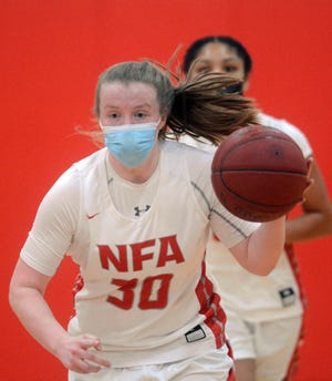 NFA's Caitlin Daley brings the ball up court against Montville during NFA's 52-23 win last Friday night in Norwich.