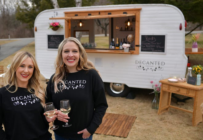 Melissa Costa and Julia Walderzak, owners of Decanted, outside their new wine truck named Wynona, March 16, 2021.