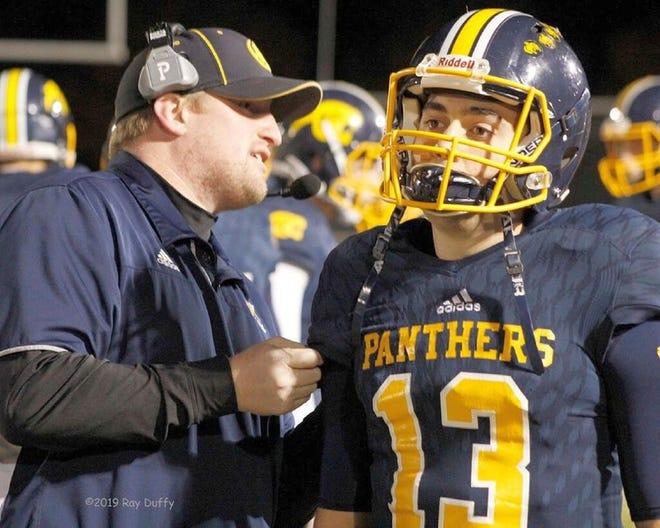 Quabbin coach Dave Buchanan talks to former quarterback Sam Coppolino during a game in 2019.