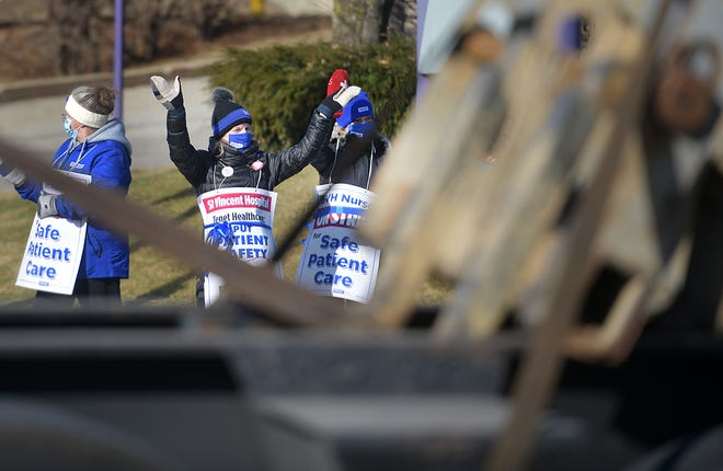 WORCESTER - A nurse raises her arms in a show of thanks as a trucker honks outside St. Vincent Hospital on Tuesday.