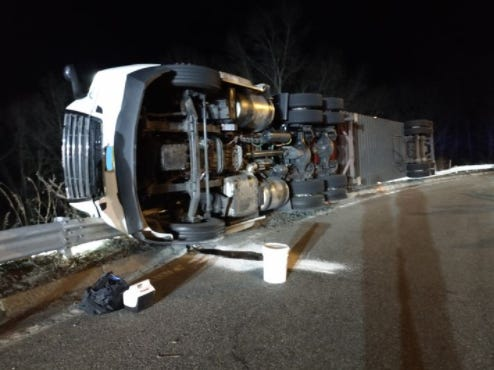 The truck, which crashed about 12:30 am. Tuesday, was hauling car batteries.