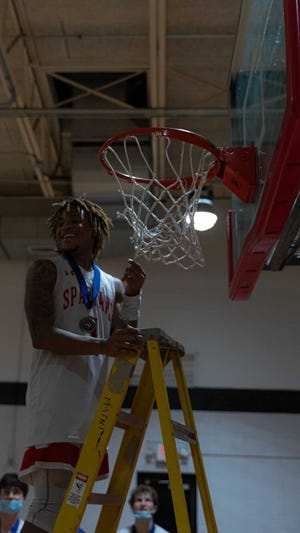 Senior point guard Jamarii Thomas celebrates after The Burlington School's 72-52 win over Northwood Temple Academy in the NCISAA 2-A boys' basketball state championship game on Feb. 27, 2021.