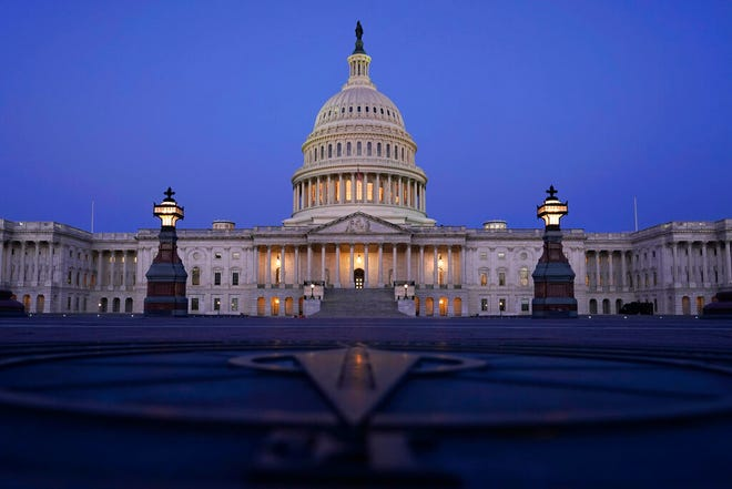 FILE - In this March 5, 2021, file photo The Capitol is seen just before sunrise in Washington. The state across the South are the center of the upcoming once-a-decade redistricting battle. The region is the fastest-growing in the country and as a result will be adding an estimated half-a-dozen House seats. (AP Photo/Carolyn Kaster, File)