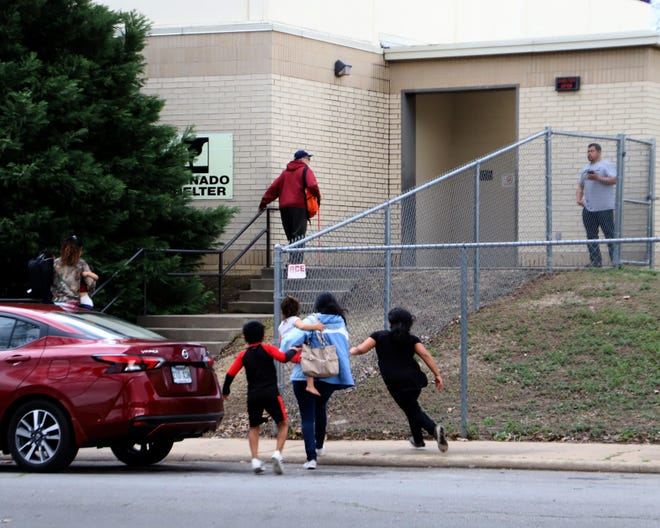 Families arrive at the Howard Elementary Tornado Shelter on North Eighth Street in Fort Smith on March 9, 2020, during a tornado warning.