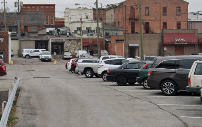 MOHIO Pizza at 23 N. Sandusky St. will be permitted to install a rear patio for seating, along with a 6-foot privacy fence to hide diners' view of trash bins and this parking lot.