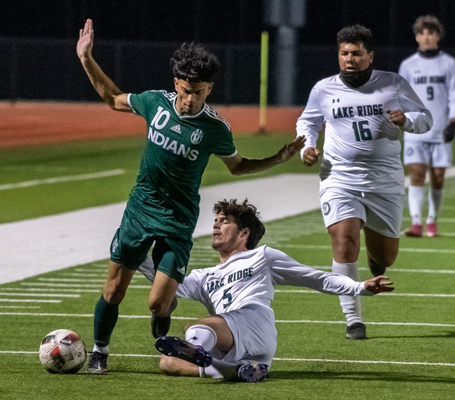 Waxahachie senior Bryan Dominguez (10) fights through a challenge by a Mansfield Lake Ridge player during a match earlier this season. The Indians will be the No. 4 seed out of District 11-6A in the upcoming playoffs.