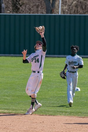 Waxahachie infielder Casey Kelly gloves a pop-up as outfielder Xavien Thompson backs him up during a recent game against Birdville at Richards Park. The Indians enter District 11-6A play on a down note after two tough losses in the Drew Medford Tournament.