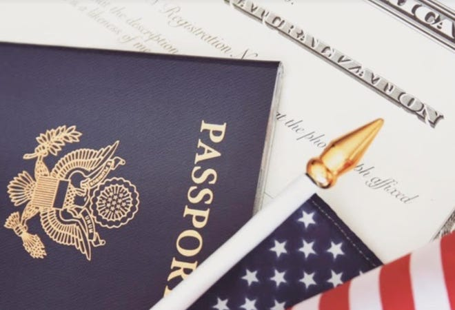 U.S. Passport and Social Security Card with an American flag.