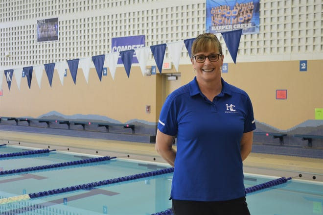 Corrin Buck is stepping down as coach of the Harper Creek girls swimming team after leading the program for more than 25 years.