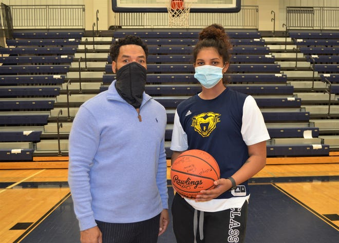 Battle Creek Central standout Arieonna Ware, right, set the city all-time career record for career points by a boys or girls basketball player on Monday. She is joined by BCC head coach Tony Warren.