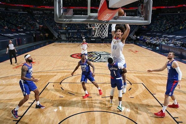 Jaxson Hayes #10 of the New Orleans Pelicans dunks the ball on the Los Angeles Clippers' Reggie Jackson #1 on March 14, 2021 at the Smoothie King Center in New Orleans, Louisiana.