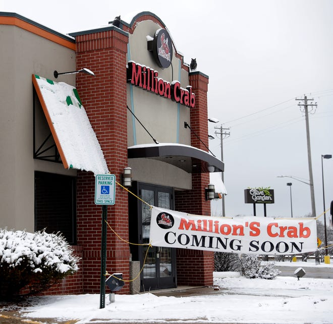 """A """"coming soon"""" sign is displayed March 16 in front of this Million's Crab restaurant in Ashwaubenon, Wisconsin."""