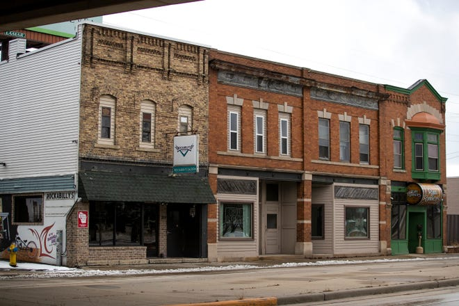Rockabilly's Saloon, 709 S. Broadway, and RumRunners, 715 S. Broadway, in Green Bay. A bartender at Rockabilly's was stabbed Monday night. She ran to RumRunners for help. A man in a vehicle further down the block was stopped for a train and was also stabbed, Green Bay police say, and died from his injuries.