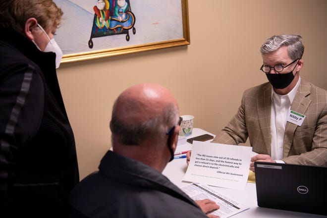 Nibby Priest meets with Joann and Rodney Kuhlenschmidt after their taxes were prepared as part of the Volunteer Income Tax Assistance Program located at the Henderson Housing Authority Monday evening, March 15, 2021.