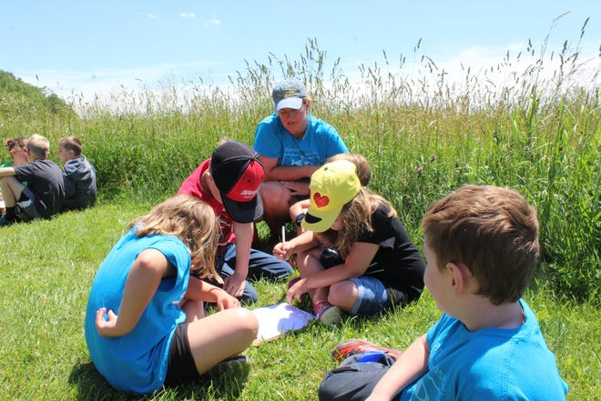 Emily Ollervides teaches campers citizen science at ECO Camp at the ECO Center in Caledonia.