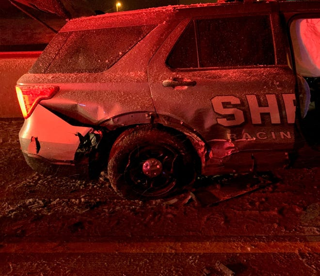 A Racine County Sheriff's Office squad car was damaged along Interstate 94 when a vehicle lost control and crashed into the squad and a tow truck nearby,