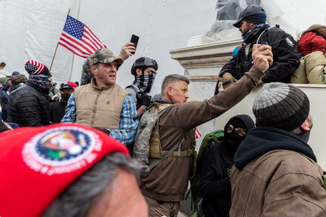 A photo included in a motion from the United States Attorney's Office for the District of Columbia allegedly shows Christopher Worrell spraying pepper spray gel toward law enforcement officers outside the U.S. Capitol building on Jan. 6, 2020.