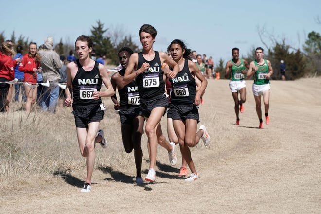 Mar 15, 2021; Stillwater, Oklahoma, USA; Blaise Ferro (667), Nico Young (675), Abdihamid Nur (672) and Luis Grijalva (669) of Northern Arizona run in the men's race  during the NCAA Cross County Championships at the OSU Cross Country Course. NAU won the team title over Notre Dame 60-87.  Mandatory Credit: Kirby Lee-USA TODAY Sports