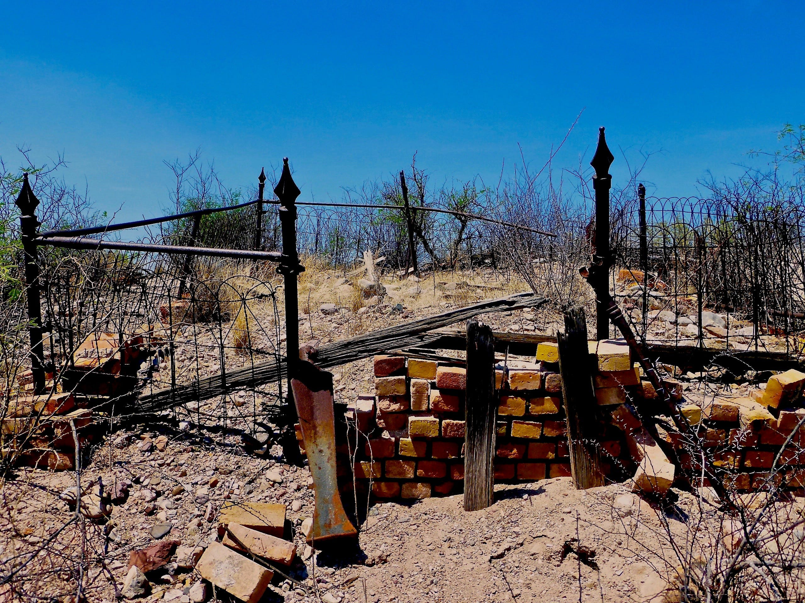 A dilapidated cemetery overlooks the San Pedro River on the edge of Fairbank ghost town in southern Arizona.