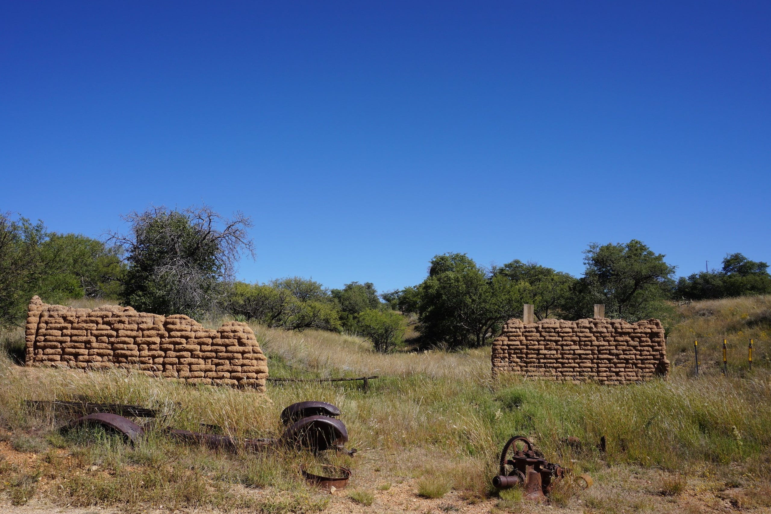Adobe walls and rusty relics can be found through the ghost town of Kentucky Camp in southern Arizona.
