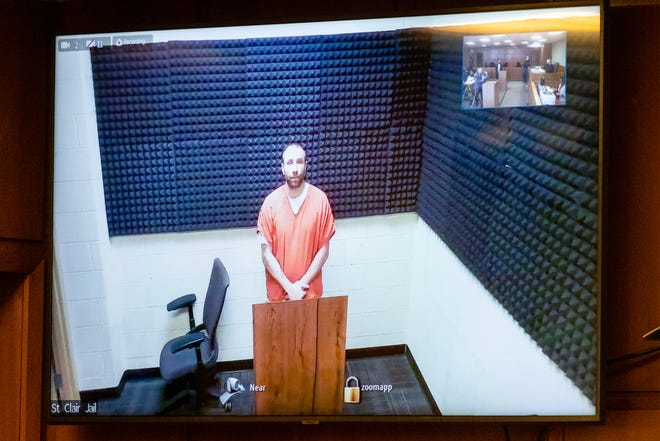 Kevin Lindke appears via Zoom from the St. Clair County Jail during a probable cause hearing Tuesday, March 16, 2021, in the St. Clair County Courthouse in Port Huron. Lindke, a former mayoral candidate, is facing charges of assaulting/resisting/obstructing a police officer, breaking and entering without the owner's permission, habitual offender third enhancement, unlawful posting of a message and cyberbullying.