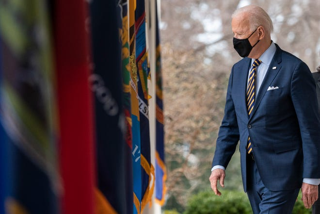 President Joe Biden walks on the Colonnade to speak about the American Rescue Plan, a coronavirus relief package, in the Rose Garden of the White House, Friday, March 12, 2021, in Washington. (AP Photo/Alex Brandon)
