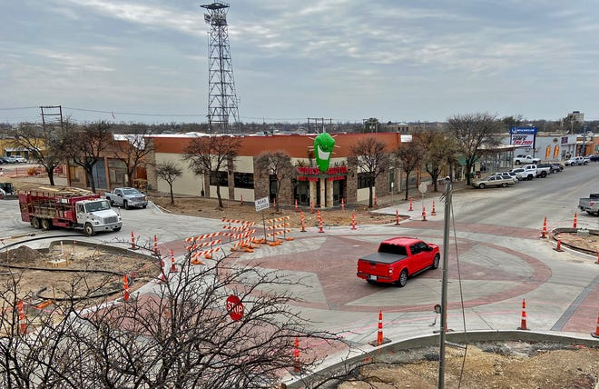 Work continues on a road improvement project in downtown San Angelo at the intersection of Chadbourne Street and West Concho Avenue on Tuesday, March 16, 2021.
