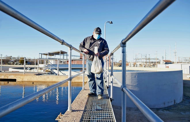 Ricky Vordick, water treatment plant operator with the city of San Angelo, conducts a routine check on the water treatment process at the city's production plant on Saturday, Feb. 20, 2021.