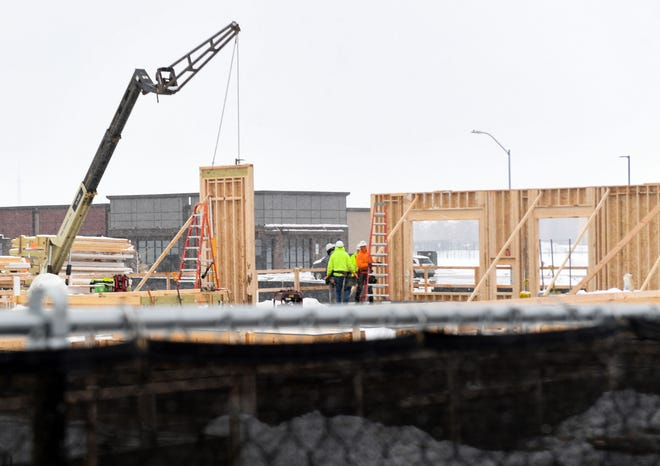 Construction work continues on Tuesday, March 16, 2021, on Success Street in northern in Sioux Falls.