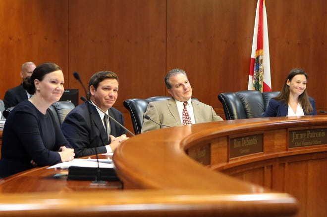 Gov. Ron DeSantis, second from left, presides over the Florida cabinet meeting consisting of Attorney General Ashley Moody, left, Chief Financial Officer Jimmy Patronis, and Commissioner of Agriculture Nikki Fried, far right,  June 4, 2019, in Tallahassee.